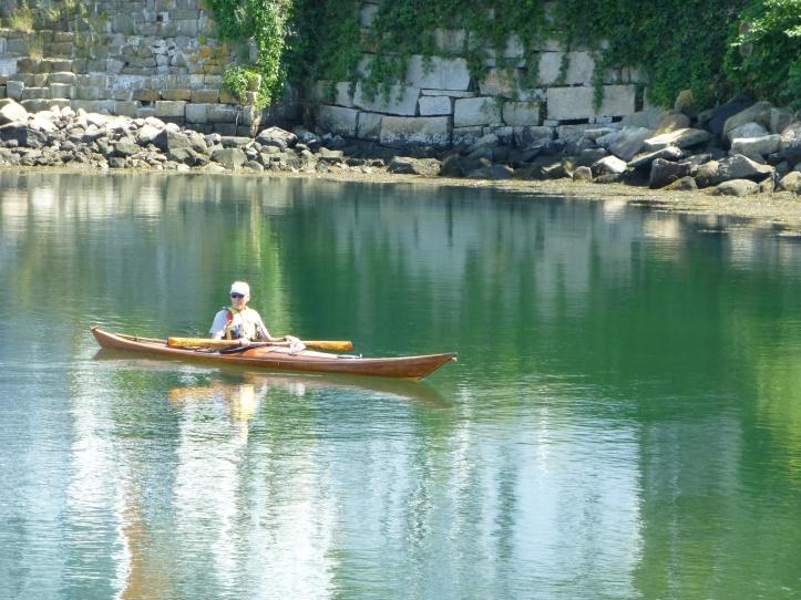 Kayaker in harbor.