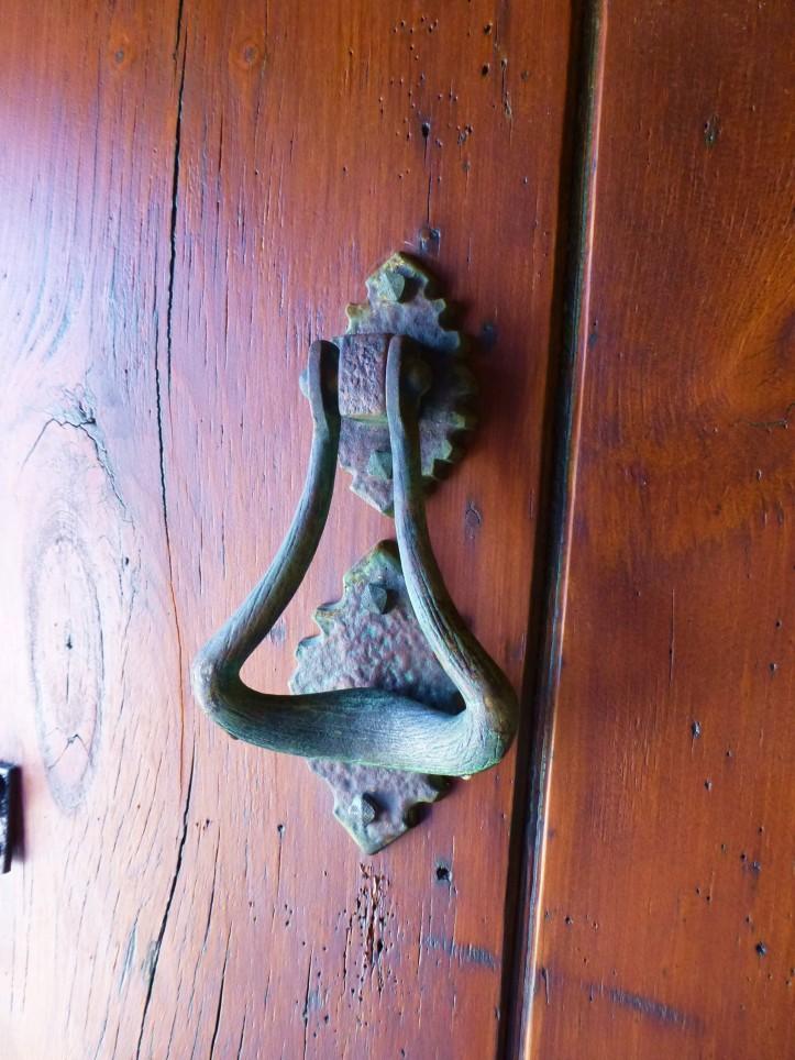 A brass door knocker welcomes you.